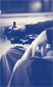 Man controlling power wheelchair